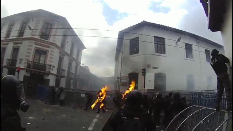 Ecuador riot officer hit with petrol bomb