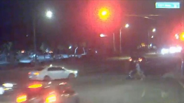 Car jumps red light and heads straight for pedestrians in Phoenix