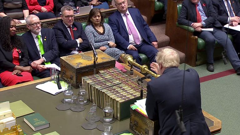 Boris Johnson speaks at PMQs as Jeremy Corbyn listens