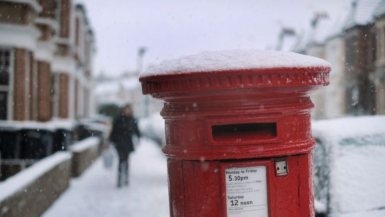 A post box covered with snow in Clapham, London