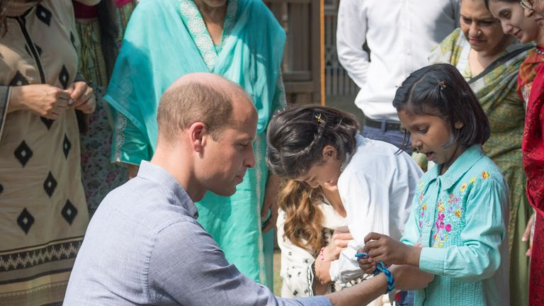 Prince William presented with handmade bracelet by little girl in Lahore, Pakistan