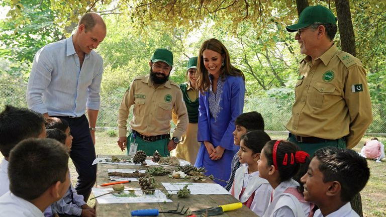 Prince William, Duke of Cambridge and Catherine, Duchess of Cambridge talk with local school children in the Margallah Hills on the second day of the royal visit to Pakistan on October 15, 2019 in Islamabad, Pakistan