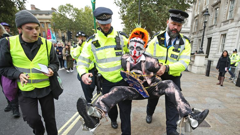 Police hold a protester during an Extinction Rebellion (XR) demonstration in Westminster, London. PA Photo. Picture date: Monday October 7, 2019. See PA story ENVIRONMENT Protests. Photo credit should read: Yui Mok/PA Wire