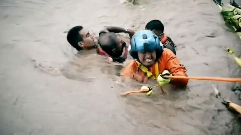 Several people stranded in a field which was inundated by rains from Tropical Storm Narda were rescued in Mexico