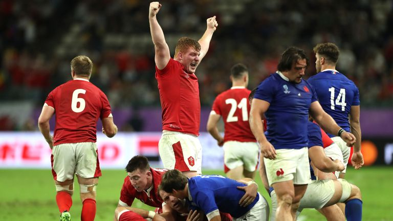 Rhys Carre of Wales celebrate victory over France