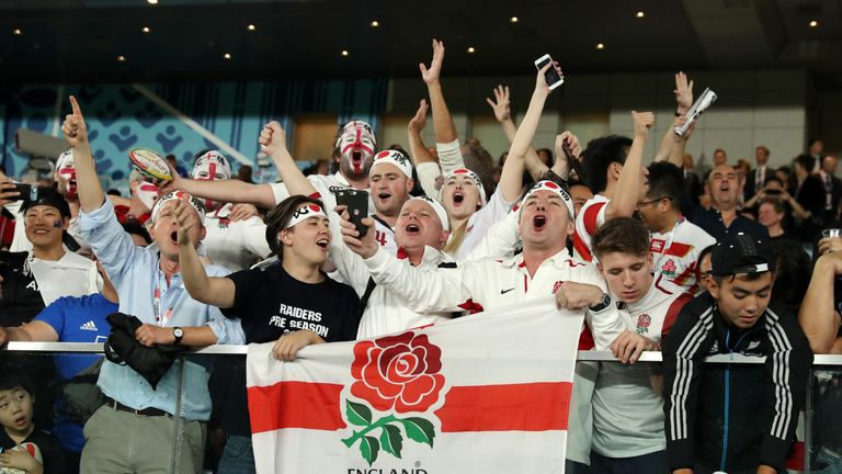 England fans celebrate their side reaching the Rugby World Cup final