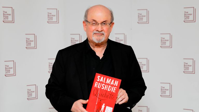 British author Salman Rushdie poses with his book Quichotte during the photo call for the authors shortlisted for the 2019 Booker Prize for Fiction