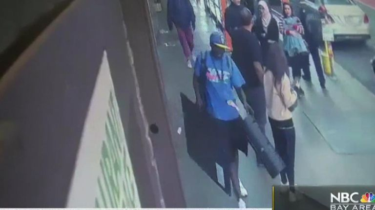 The man walked off down Geary St with the artwork. Pic: NBC Bay Area