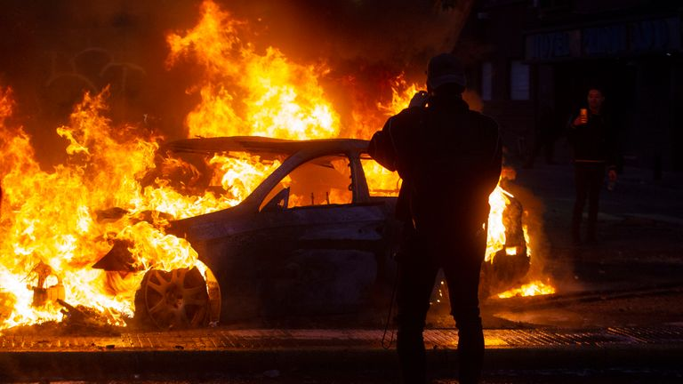 A car burns during violent protests in Santiago, Chile