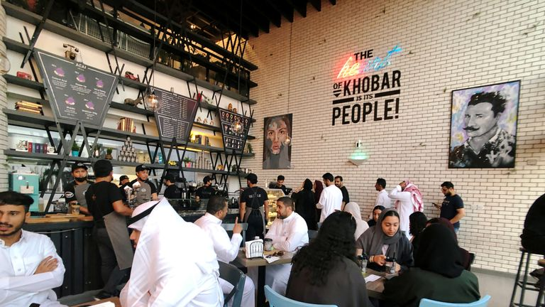 Saudi women sit among men in a newly opened cafe in August