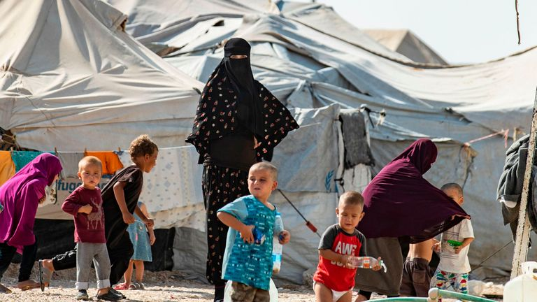 Women look after children at the Kurdish-run al-Hol camp for the displaced where families of Islamic State (IS) foreign fighters are held