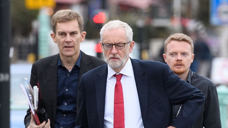Labour party leader Jeremy Corbyn (C) arrives with political aide Seumas Milne (L) and Labour activist Andrew Fisher