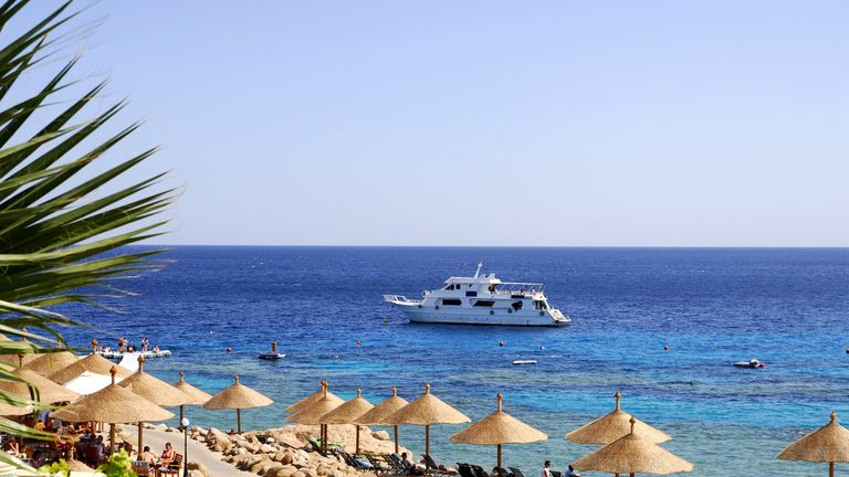 Tourists sunbathe at the Red Sea resort of Sharm el Sheikh