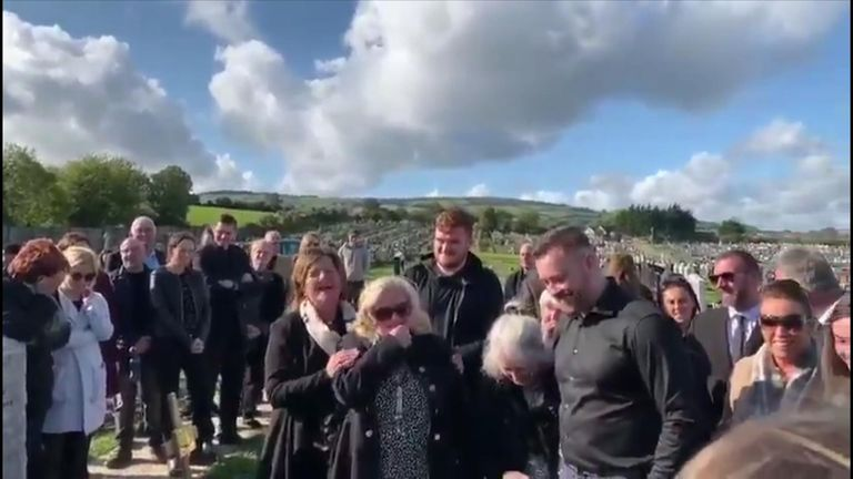 Mourners laugh as Shay Bradley's voice can be heard from beyond the grave