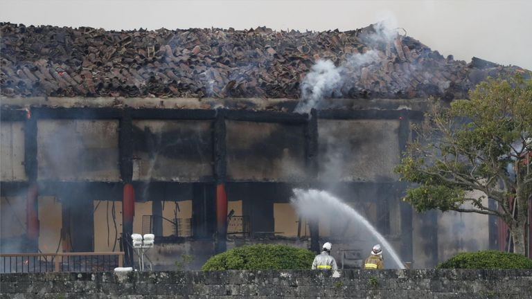 Firefighters were still battling the blaze hours later. Pic: Kyodo/Reuters