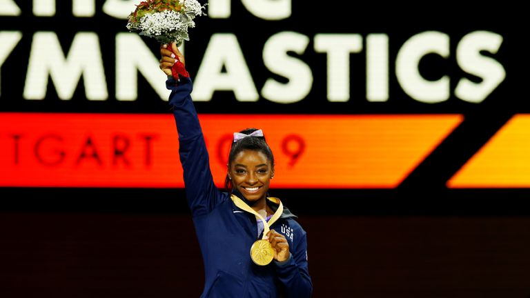 Biles with her gold medal after the winning the balance beam final
