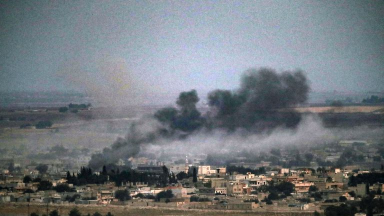Smoke rises over the Syrian town of Ras al-Ain during Turkey's military offensive