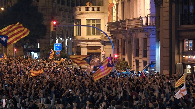 Several hundred protesters surround the Spanish police headquarters in Barcelona