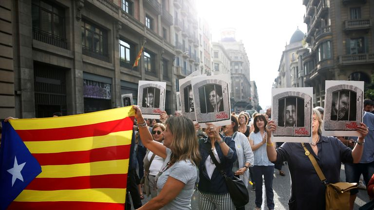 Protesters walked through Barcelona's main thoroughfare, Via Laietana, with Catalan flags and the pictures of those jailed after the sentencing