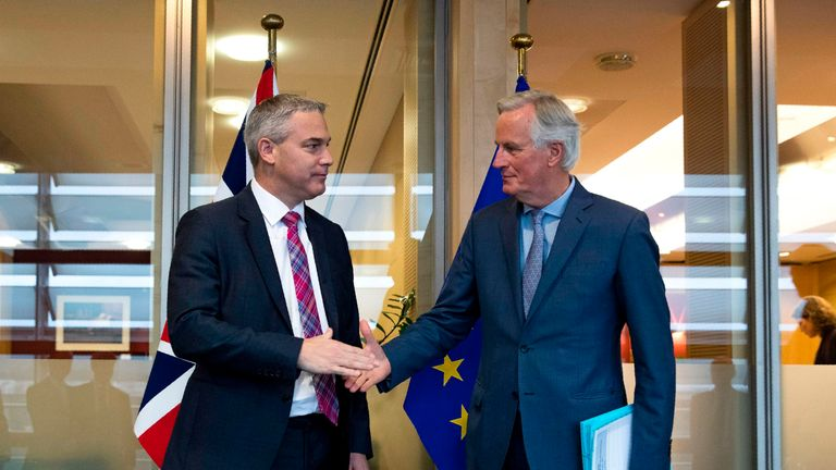 Britain's Secretary of State for Exiting the European Union Stephen Barclay (L) shakes hands with European Union chief Brexit negotiator Michel Barnier before their meeting at the European Commission headquarters in Brussels, on October 11, 2019. (Photo by Francisco Seco / POOL / AFP) (Photo by FRANCISCO SECO/POOL/AFP via Getty Images)