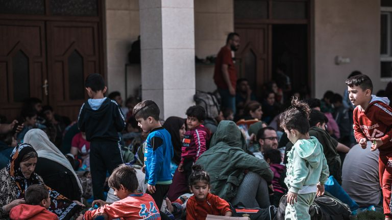 Refugees wait at a reception centre near the Iraq-Syria border. Pic: Alan Ayoubi /NRC