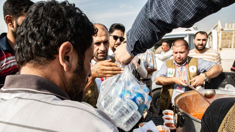 NGOs have been providing drinking water and food to refugees at the Bardarash Camp. Pic: Tom Peyre-Costa/NRC
