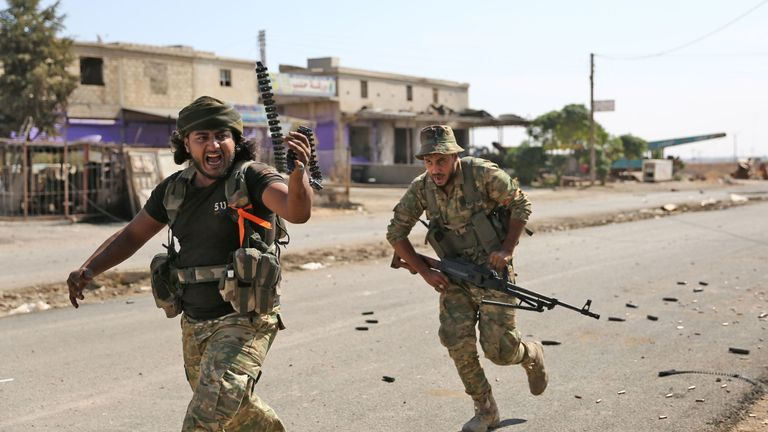 Turkish-backed Syrian fighters battle in Syria's northeastern town of Ras al-Ain