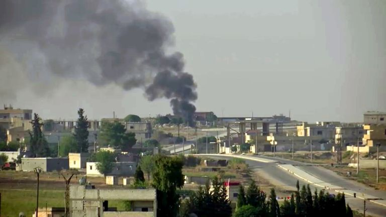Smoke billows out in the Syrian border town of Tel Abyad, as seen from Akcakale, Turkey