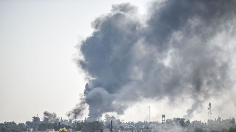 A picture taken in Akcakale at the Turkish border with Syria on October 10, 2019 shows smokes rising from the Syrian town of Tal Abyad after a mortar landed in the garden of a Turkish government building in Akcakale. - Three officers have been severely injured by a mortar fired from Syrian area of Tal Abyad that landed in a Turkish government building's garden in Akcakale in Sanliurfa province. (Photo by BULENT KILIC / AFP) (Photo by BULENT KILIC/AFP via Getty Images)
