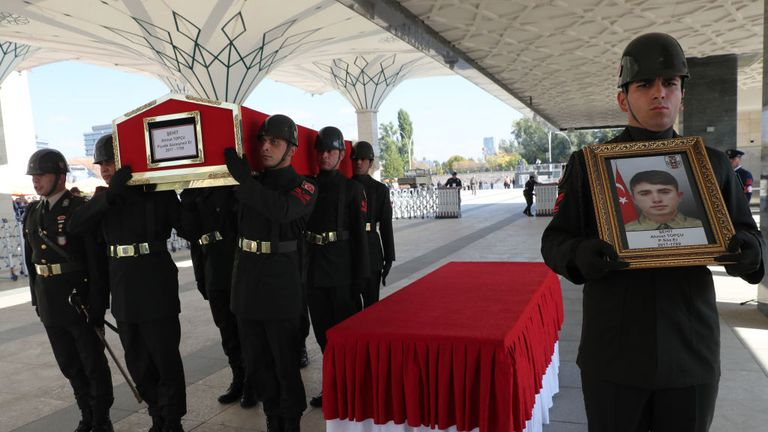 Turkish soldiers carry the coffin of Turkish infantry soldier Ahmet Topcu in Ankara, after he was killed fighting the YPG in Syria on Friday
