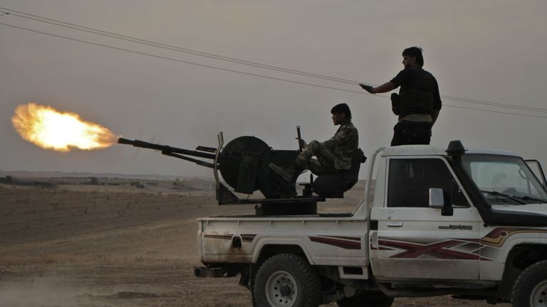 Turkish-backed Syrian fighters fire a truck mounted heavy gun near the town of Tukhar, north of Syria's northern city of Manbij, on October 14, 2019, as Turkey and it's allies continues their assault on Kurdish-held border towns in northeastern Syria. - Turkey wants to create a roughly 30-kilometre (20-mile) buffer zone along its border to keep Kurdish forces at bay and also to send back some of the 3.6 million Syrian refugees it hosts. (Photo by Aref TAMMAWI / AFP) (Photo by AREF TAMMAWI/AFP vi