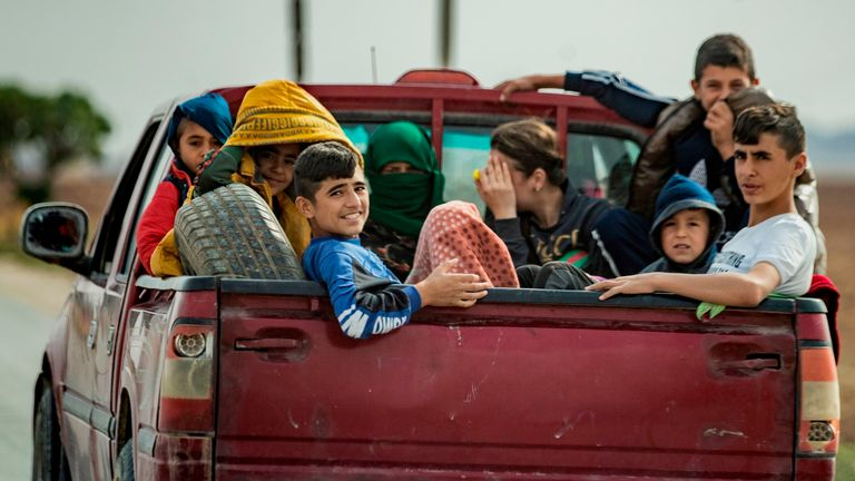 Syrian Kurdish and Arab families flee the town of Darbasiyah on the Turkey-Syria border