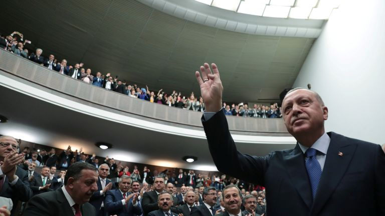 Turkish President Tayyip Erdogan greets members of his ruling AK Party in Ankara, Turkey on Wednesday
