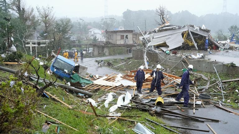 Destroyed houses, cars and power poles, which according to local media were believed to be caused by a tornado, are seen as Typhoon Hagibis approaches