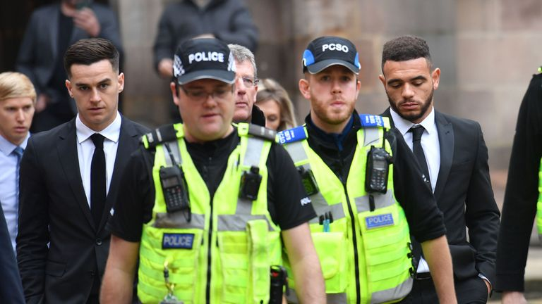 Police escort Tom Lawrence (far left) and Mason Bennett (far right) from Derby Magistrates' Court