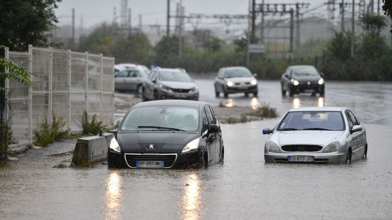 Vehicles are stuck in a floods following overnight storms in Bezier, southern France