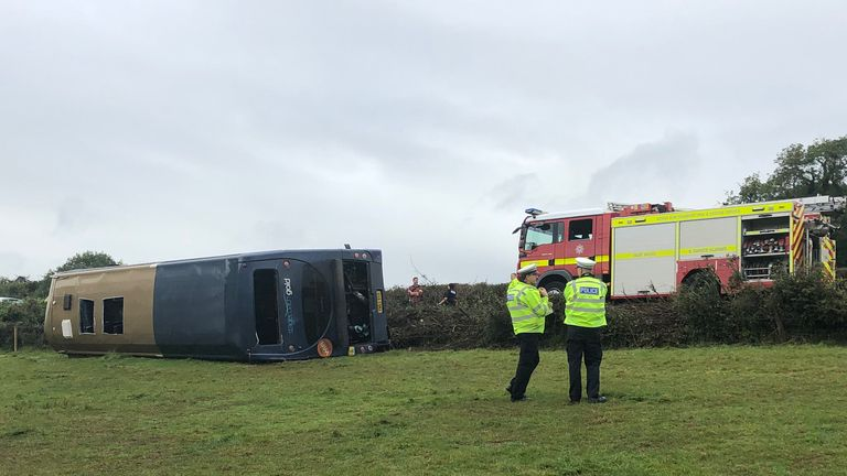 The bus overturned into a field. Pic: AM Gerald Taylor, DSFRS