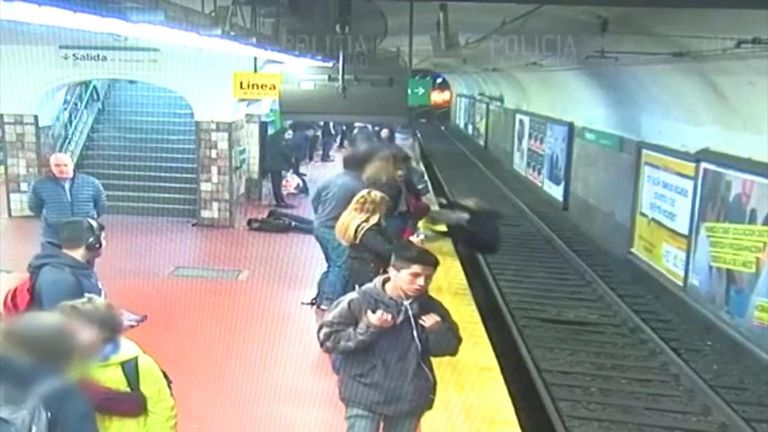 A man fainted who then inadvertently pushed a woman off the platform and directly onto the tracks in front of an incoming train.