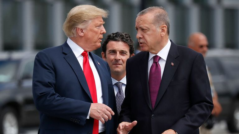President Donald Trump, left, talks with Turkey's President Recep Tayyip Erdogan, as they arrive together for a family photo at a summit of heads of state and government at NATO headquarters in Brussels. The White House says Turkey will soon invade Northern Syria, casting uncertainty on the fate of the Kurdish fighters allied with the U.S. against in a campaign against the Islamic State group. (AP Photo/Pablo Martinez Monsivais, File)