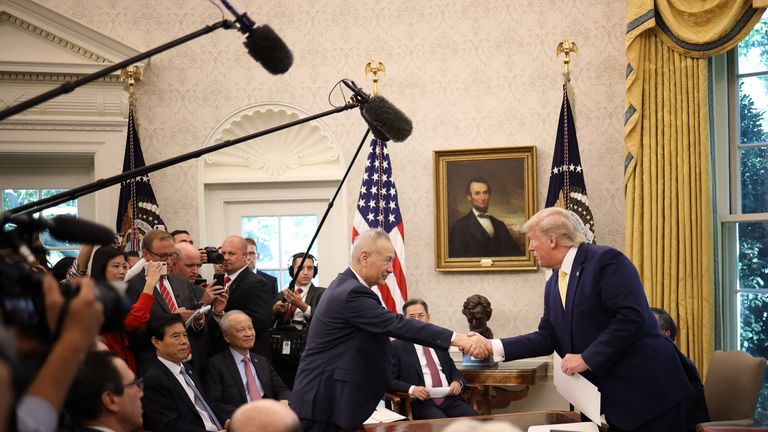 "U.S. President Donald Trump shakes hands with Chinese Vice Premier Liu He after announcing a ""phase one"" trade agreement with China in the Oval Office at the White House October 11, 2019 in Washington, DC"