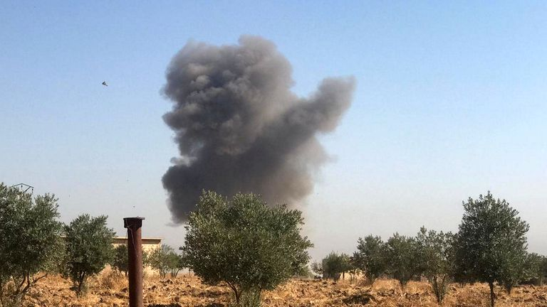 Smoke rises from Tel Arkam village in Ras al Ain countryside, Syria