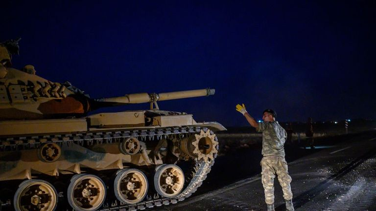 A Turkish army tank drives towards the border with Syria near Akcakale in Sanliurfa province