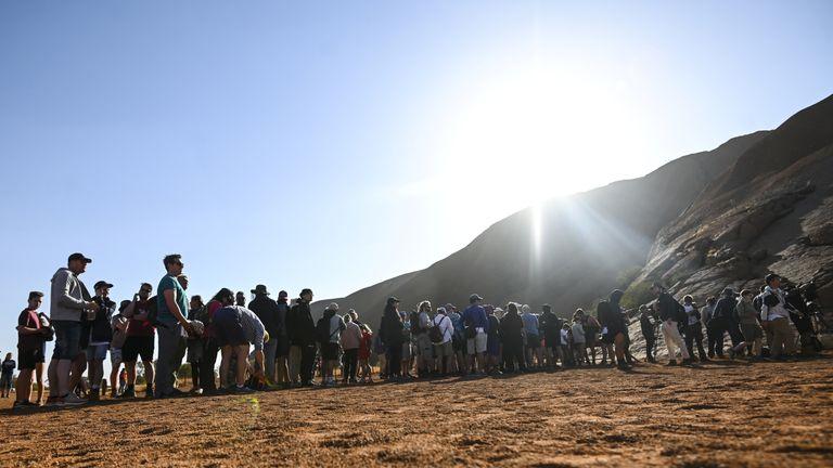 Tourists line up to climb Uluru