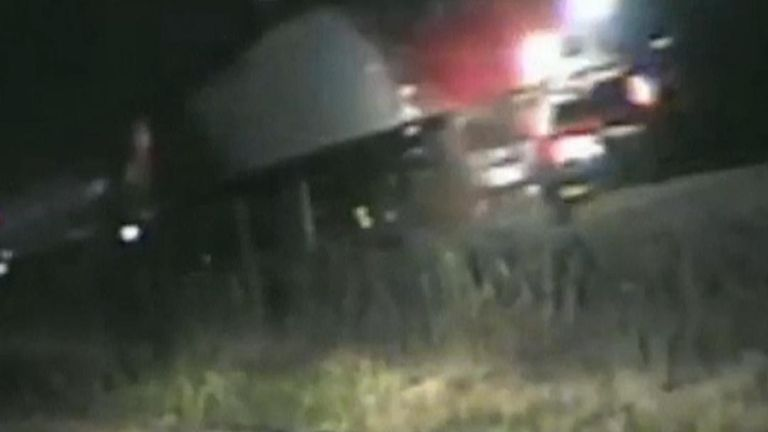Police rescue man stuck in car on train tracks seconds before a train rams the vehicle