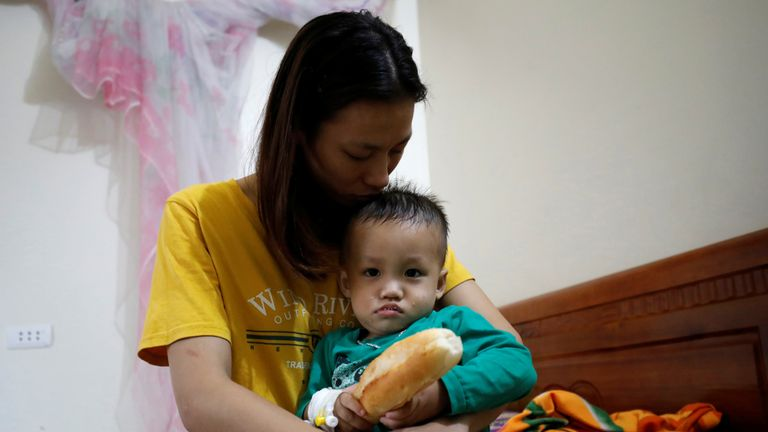 The wife and child of suspected victim Nguyen Dinh Tu