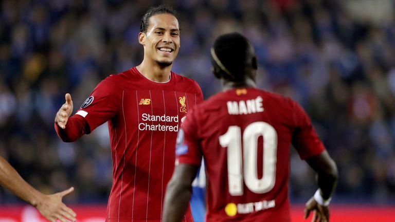 Virgil van Dijk and Sadio Mane celebrate during Liverpool's Champions League win over Genk this week