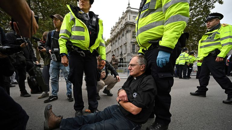 Police arrest a vicar who was protesting near Downing Street