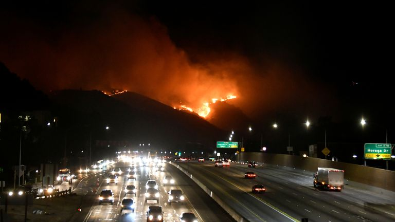 The Getty Fire burns next to the 405 freeway in the hills of West Los Angeles
