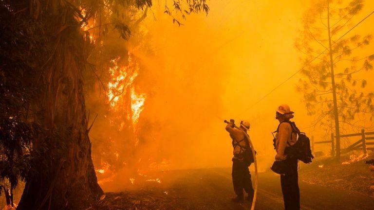 Firefighters battle the Kincade Fire in Healdsburg, California