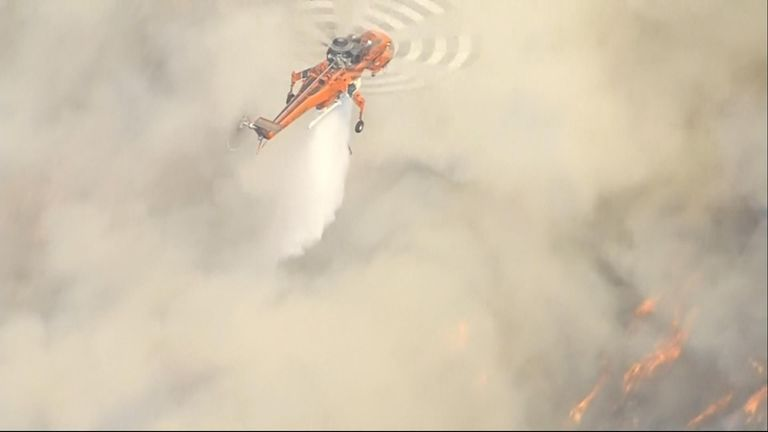 A brush fire in the Pacific Palisades neighbourhood of Los Angeles was creeping dangerously close to homes